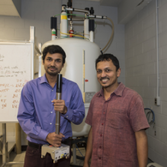 Anand Yethiraj (right) and graduate student Swomitra Palit (left) in the Nuclear Magnetic Resonance lab at Memorial University.